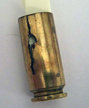 Cracked 10mm cases I found on the range.-10mm-cracked-case.jpg